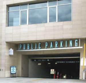 Big 'Public Parking' sign on parking garage